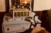 antique painted dresser with mirror and chair in front