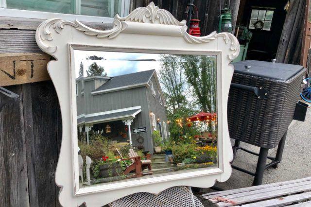 white antique mirror with ornamental border