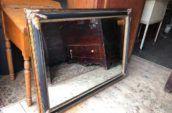 Beveled mirror, ornate frame