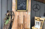 door with chalkboard and sleds leaning against it