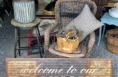 farmhouse sign and wicker chair