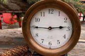 an antique brass clock