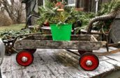 antique children's wagon with Christmas decorations inside
