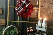 a Christmas wreath hanging on an antique window frame