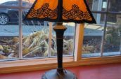antique lamp with black and orange shade