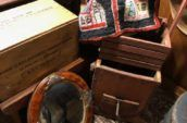 various antiques including wooden crates and an old mirror