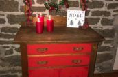 wood dresser with red drawers