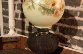 Early wicker lantern with globe