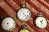 four vintage pocket watches
