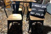 four small wood chairs with black pillow covered in typography