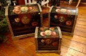 three small boxes covered with floral pattern