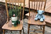 ornate wood chairs with plant pot and stuffed bear on them