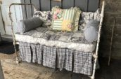 Shabby iron bed with textiles