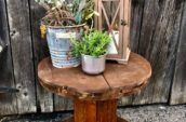antique wooden side table with a lantern and two plants on top