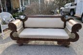 large white cushioned cherry and stained wooden couch