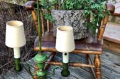 wooden rocking chair with antique green table lamp in front