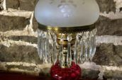 antique glass and crystal table lamp with a gold base