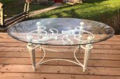 white metal table with a clear glass tabletop
