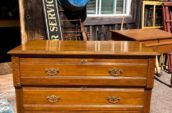 wooden dresser with gold handles