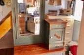 antique wooden vanity with large mirror