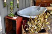 blue bath tub with antique wooden boxes