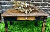 antique wooden table with small pull out drawer with white handle