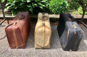 three vintage luggages