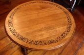 antique wooden tabletop with carved out detailing