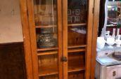 antique wooden display case with glass doors