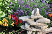 stone formation with flowers in the background