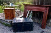 picture of black wooden box, wooden cabinet and wooden frame with tables and chair in the background
