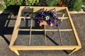 wooden table with flowers on top