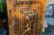 wooden cabinet with trees and birds design