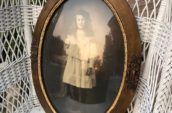 antique photo frame with a photo of a woman in white dress