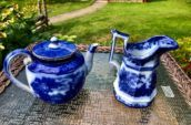 two ceramic teapots on a table