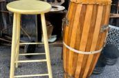 tall wooden chair next to a tall wooden drum