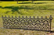 fence on a grassy field.
