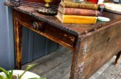 wooden table with single drawer and folding side