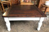 square wooden coffee table with legs painted white