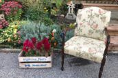 antique upholstered chair with floral design